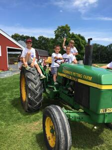 Domino's Farms Field Trip Kids on John Deere Tractor